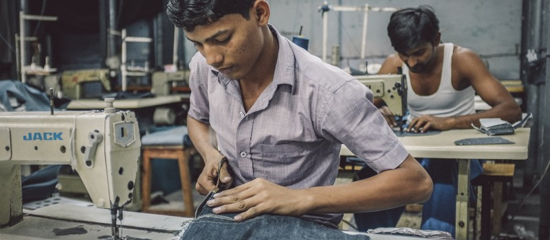 Indian workers sewing